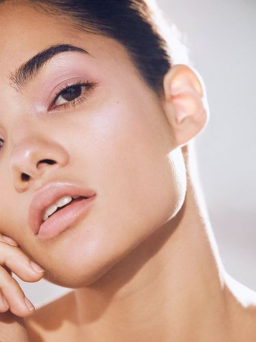 Why Everyone Is Adding This Unexpected Highlighter Color to Their Beauty Bags