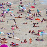 The Horrifying Reason You Shouldn't Rely on Beach Umbrellas For Sun Protection