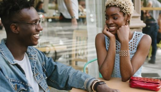 10 Subtle Signs A Woman May Be Flirting, From Body Language Experts