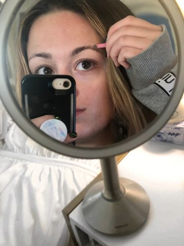 This Simplehuman Sensor Mirror Trio Review Proves Lighting Affects Your Makeup Routine In A Big Way