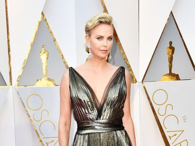 Charlize Theron Said 'Screw It' and Put Her Hair Up in the Ponytail Holder She Had Around Her Wrist